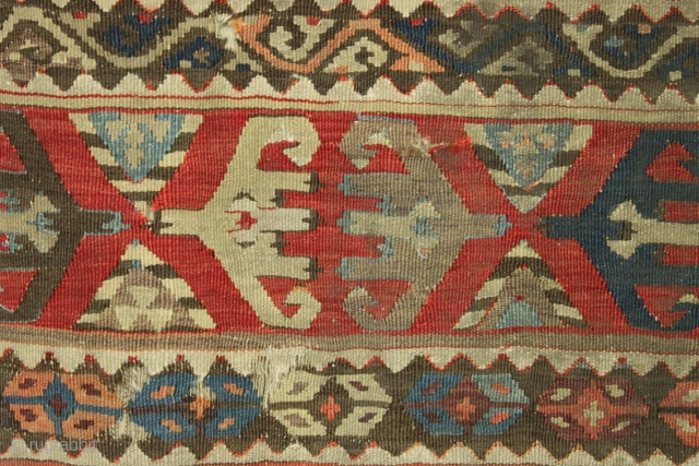 "Antique Turkish Kelim fragment. Old piece. Very very very dirty. Sewn on to cloth. Ca. 1850? app. 2'6"" x 3'10"""