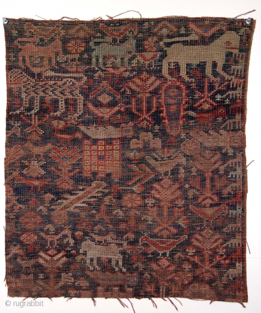 """Another antique SW Persian rug fragment. Charming menagerie with a lion, a tiger, many birds, dogs in a forest of  vegetation?. Lower than low pile. Almost imaginary. Color? Age? 18"""" x  ..."""