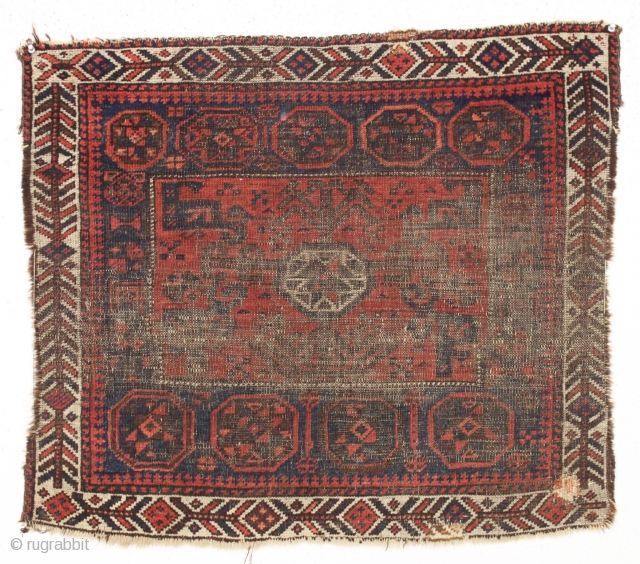 "antique baluch square middle bagface. Another piece fresh from a local Boston home. Thin but genuine,  with considerable wear and priced accordingly. 19th c. 29"" x 34"""