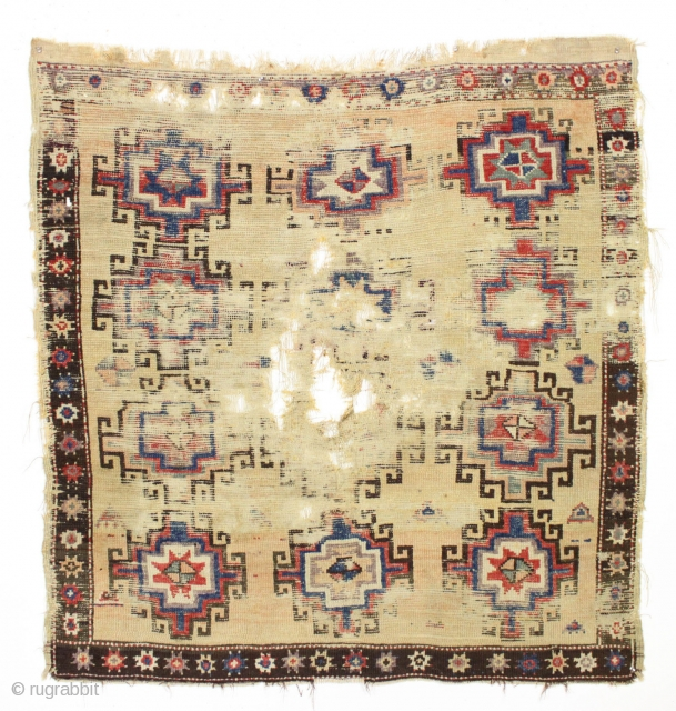"""Antique anatolian rug. Old survivor, barely. One could wax poetic on this relic. Or not. 4'7"""" x 4'11"""""""