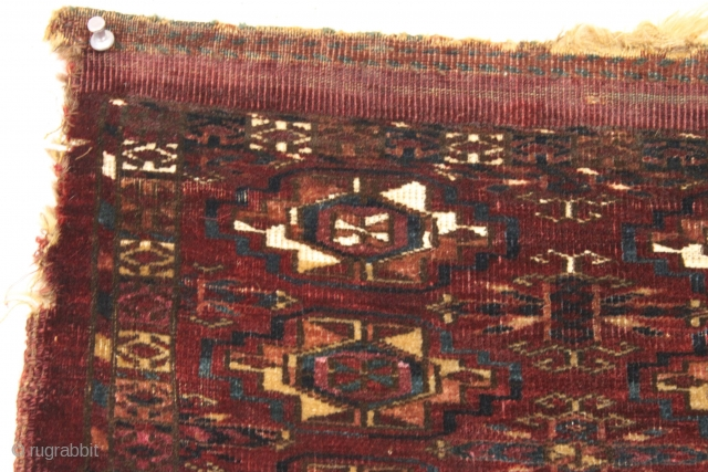 "Antique little tekke mafrash. Small dark and handsome. Just a very few knots of magenta silk and a few small areas of white cotton. Old piece. 12"" x 32"""