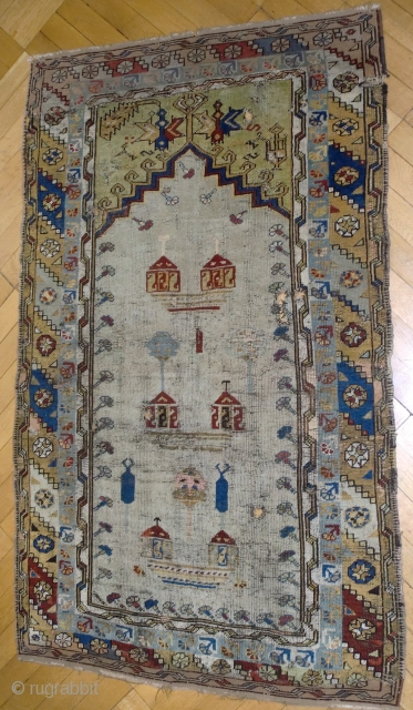 Important 18th C White field Konya, Ladik rug 180/100 cm. The upper part ( 15 cm ) and the lower part (5 cm) have been rewoven long ago. A few small repairs  ...