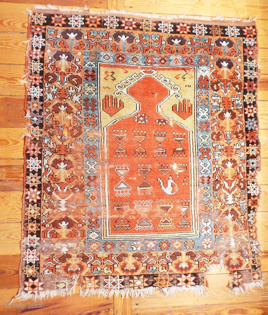 I do hate the description 'museum piece' but in this case you are looking at one. Konya before 1800. Fairly large sized for an anatolian prayer rug, 130x120cm. If seriously interested please  ...