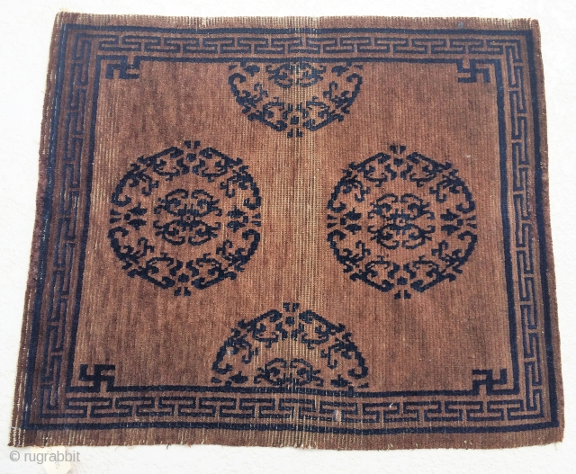 """Tibetan Sitting Rug: 29"""" x 25""""  I believe the background maybe undyed.  the design color is dark blue.  Great design with ware as shown in picture."""