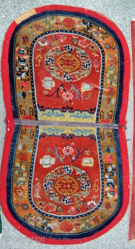 """Tibetan Under Saddle Rug 49""""x26.5"""".  More desirable oval shape with some signs of use. 1930s with cotton warps and wefts.  Typical colors for time period with great design."""