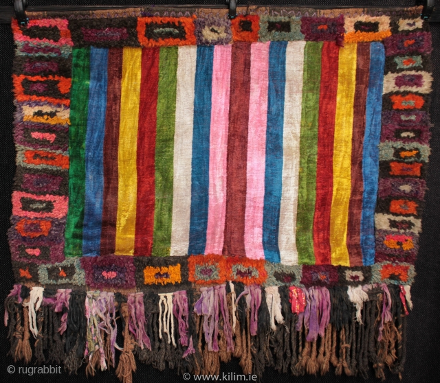 Mystery weaving of unknown use and origin.  Thick wool pile on a coarse striped flatweave foundation woven with natural dark and mid brown sheep wool in two panels on a narrow hand loom.  ...