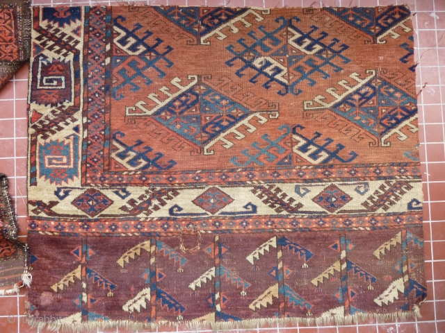 Fragment of a fine old Yomud main carpet. A complete sample: border, skirt and field. As found condition, needs a bath and a good home. 104cm x 84cm