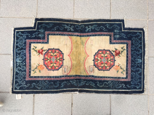 "Tibetan horse saddle rug, light yellow background with group flower pattern, around Chinese eight treasures veins selvage. About 120 years old. Good age and condition. Size 123*61cm(47*24"")"