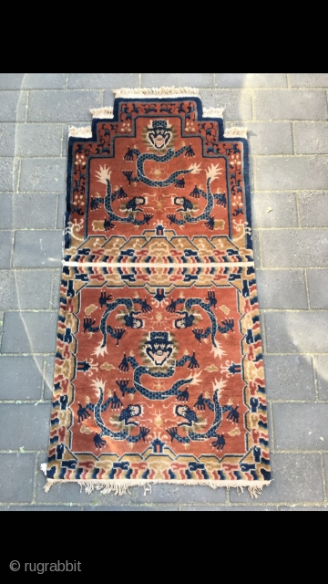 """#2029 Baotou rug, it was produced in Baotou area in Inner Mongolia. A sit mat with back. Red background with lively dragon pattern, lucky cloud salvage. Good age and quality. Size 145*75cm(57*29"""")"""