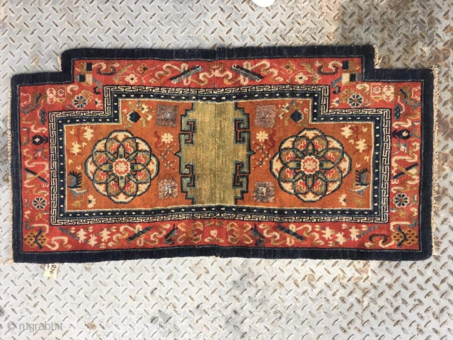 """Tibetan  horse saddle rug, Orange background color with group flower pattern, Chinese traditional eight treasures selvage. Good age and condition. Size 65*138cm (25*54"""")"""