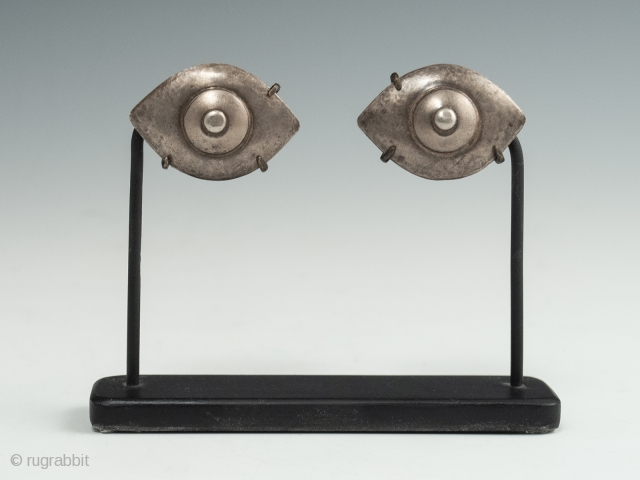 "Silver eyes, China or India. 1.25"" (3.2 cm) wide each, 2.75"" (7 cm) high, as based