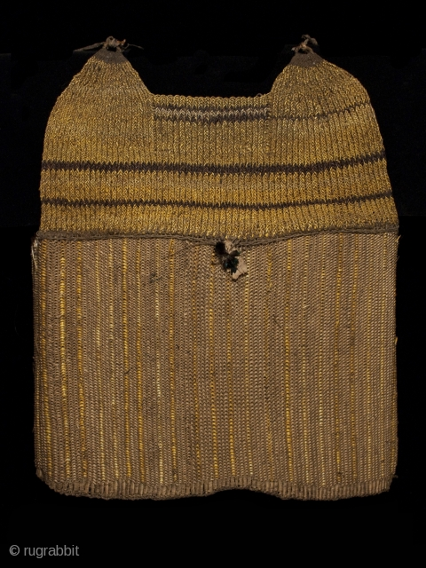 """Armor vest or cuirass Tin (Western Dani) or Kabasi (Moni), Baliem Valley, West Papua Orchid fiber (Dendrobiinae), rattan fiber, bird feathers 20"""" (51 cm) high Early to mid-20th century Ex. Old Dutch collection formed in the 1960s  This  ..."""