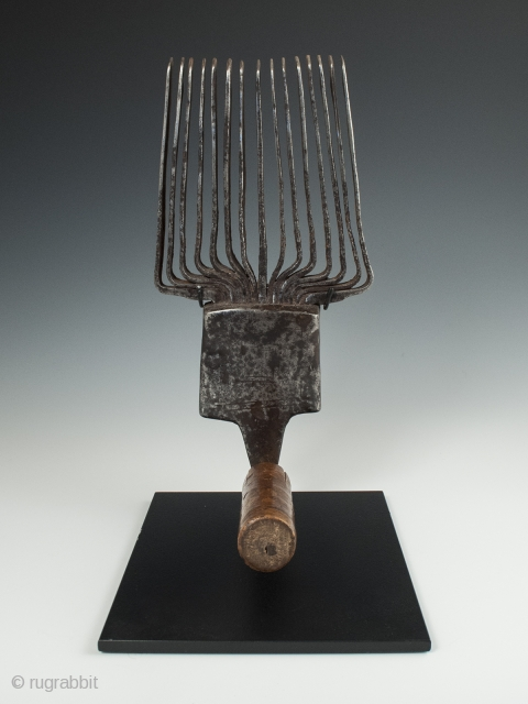 """Weaving comb (panja), Morocco. Iron, wood, 11"""" (28 cm) high by 5"""" (12.7 cm) wide by 6"""" (15.2 cm) deep. Late 19th to early 20th century.  A traditional Berber beating comb used in  ..."""