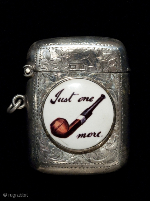 """Match safe, Unknown manufacturer, probably European. Sterling silver, porcelain. 1 7/8"""" (4.7 cm) high. c. 1895. This unique match safe has several hallmarks: two on the outside lid and four on the inner rim. The center porcelain  ..."""