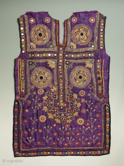 """Beautifully embroidered dress from from the Sindh area of Pakistan. Early to mid 20th century.  29"""" high by 20"""" wide. Great condition, with all mirrors in place, a few with hairline  ..."""