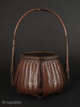Japanese Antique Bamboo Basket Signed   Japanese antique bamboo basket, with beautiful handle attached at the lower sides and bound with special decorative stylized knots. Hexagonal body of woven herringbone pattern. Feet at bottom  ...