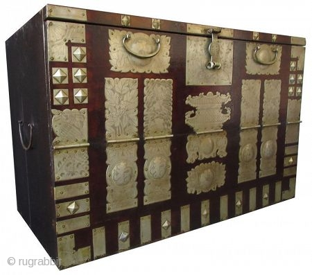 Antique Korean Ginko wood Bandaji (blanket chest)   Beautiful Northern Korean bandaji (blanket storage chest) with highly ornate white brass fittings incised with birds and flowers and auspicious symbols. The white brass plated mounts  ...