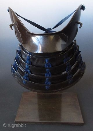 Japanese Hanpo Cheek Guard Armor Japanese samurai hanpo cheek guard armor. Black lacquered iron with 4 lamellar neck guard, laced with dark blue silk cords. The cheek guard is lacquered in red. Mounted  ...