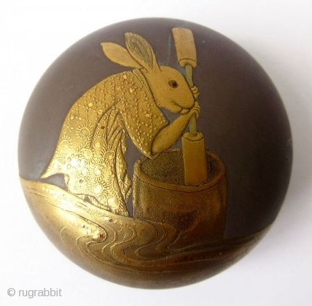 Charming 18th C. Japanese Lacquer Kogo with Rabbit Pounding Mochi A round Japanese kogo or incense box with sprinkled gold lacquer maki-e motif of an anthropomorphic rabbit pounding mochi. The rabbit wears a  ...