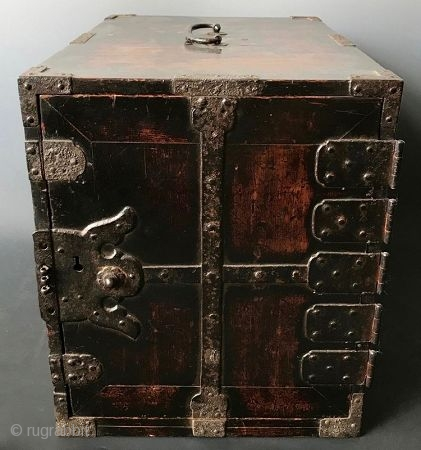 Antique Japanese Lacquered Fune Bako Japanese dark lacquered fune bake, or ship safe box with heavy hand-forged iron hardware and plates. The interior of the box holds six small drawers opened by kan  ...