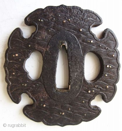Antique Japanese Iron Waves Tsuba  Japanese iron tsuba, or hand guard for a samurai's sword, with cast motifs of waves inlaid with gold and silver, the patina indicates age and wear from use.  ...