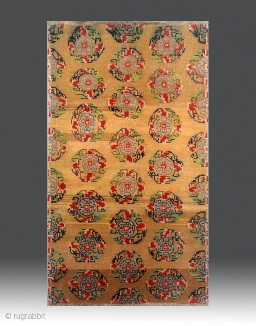 "No.M87 * Tibetan Antique""Medallion"" Rug .Size: 95x163cm(3'1""x5'4""). Origin: Tibetan.Shape: Rectangle. Background Color: Yellows .wool/wool.This Tibetan carpet is a beautiful traditional medallion rug. The multi-colored medallions have designs based upon geometrically stylized flowers.  ..."