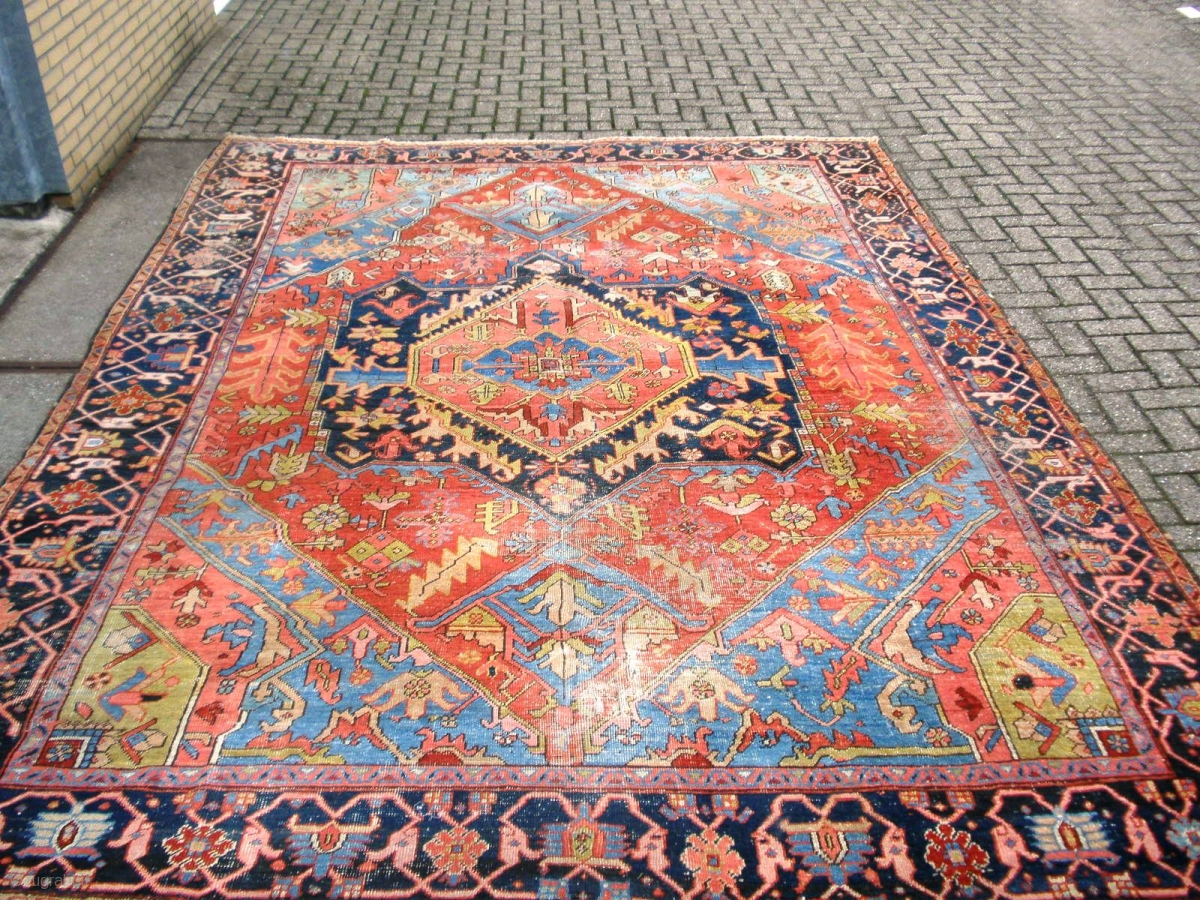 Very colorful heriz area antique rug with incredible drawn for Best area rug websites