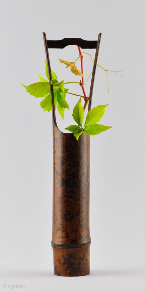 very attractive design flower vase. An elegant simple Japanese flower vase  hanaire of dark bamboo with a natural design