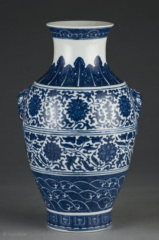 A Chinese Blue And White Porcelain Vase Depicting Lotus