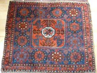 """Fine Belouchi Bagface, 19th century, 73cm x 70cm 2'4"""" x 2'3"""". This bag has wonderful wool and good colour. Interesting 'totemic' motifs in central cartouche. Generally very good condition. The pile is  ..."""