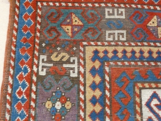 """Kazak rug, 2.40m x 1.50m, 7'10"""" x 4'11"""", 19th century. Very well-balanced design with some early features. Some minor damage, old repairs and corrosion/ replaced browns."""