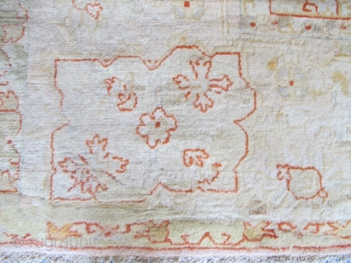 Very pale antique Borlu carpet with Angora wool, 4.54m x 3.50m. Some old repairs, but still very decorative.