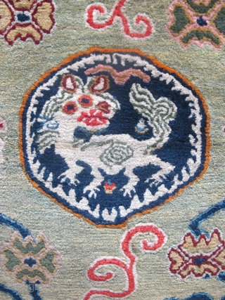 "Rare Tibetan Meditation Mat, 78cm x 65cm ( 2'8"" x 2'2""). Last quarter of 19th century. Beautiful abrashed field with a Tibetan dragon, the symbol of communication and enlightenment. Great wool quality  ..."