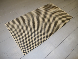"""Tibetan Checkerboard Rug, 1.62m x 0.93m (5'3"""" x 3'1"""") Alternate squares of dark blue and undyed ivory wool. Subtlety and texture are provided by the abrash and the slight variation in each of  ..."""
