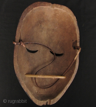 Dayak Mask: Good Kayan Orang Ulu gawai rice festival ceremonial mask, circa 40 years old, from Sarawak. I bought this piece in Kuching, Sarawak in 2003. This mask would be held by  ...