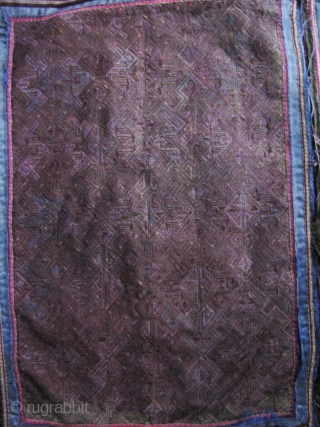 Dong Women's Jacket: Women's jacket from the Dong minority in Longsheng Terraces, Guangxi Zhuang, China. The black outer cloth is commercial denim, the lining is handmade indigo cotton with beautiful purple hand  ...