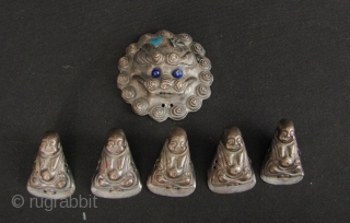 Happy Buddhas: Set of Qing Dynasty silver repoussé Chinese child's hat ornaments. Very sweet little collection of 5 Budai and a lions face. Budai H: 2.9cm/1.1in and W: 2cm/0.8in and lion face  ...