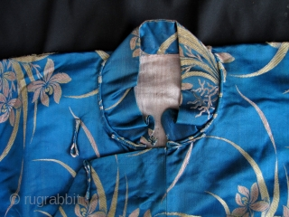 Stunning vintage/antique classic woman's blouse circa early to mid 20th century with Chinese orchid pattern, symbolizing Spring and marital harmony. Excellent condition- clean, but could use a steam press. This is all  ...