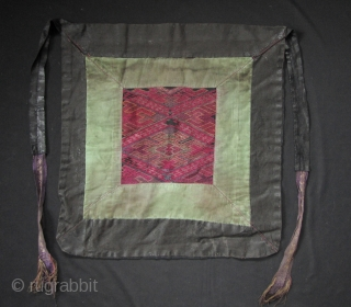Miao women's apron: Beautiful Miao woman's apron with black calendered cotton cloth, and green commercial border, and fine silk embroidered center panel with hand woven silk embellished apron ties, from Guizhou, China.  ...