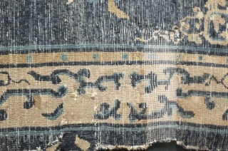 Old Chinese rug woven in Beijing/Tianjin, circa late 19th to early 20th century, with abstract archaic foliate border and ten floral sprays on the field repaired with frayed edges- still quite pretty  ...