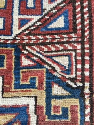 Genje Kazak with nice age (mid 19th century), fat wool and supple weave. Tribal product, no workshop stiffness in this one. Excellent pile (black corroded). Many unusual quirks, free drawing and unusual  ...