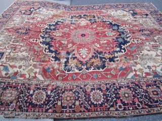 """antique heriz serapi rug measuring 9' 5"""" x 11' 3"""" great design and colors has wear but solid rug very floppy  both ends and sides are good no holes clean rug  ..."""