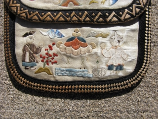 "Antique Chinese silk purse, China ca. 1920, hand embroidered on beige silk, a combination of feather stitch, brick stitch, and ""forbidden stitch"", three pockets, one on each side, worn with some missing  ..."