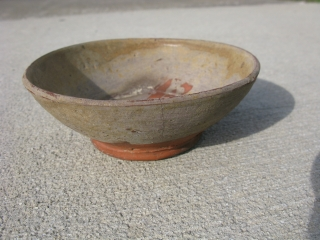 """Tang Dynasty earthenware bowl, Changsha ware, Changsha Kilns, 9thC China, a small """"wan"""" bowl for individual servings of food or tea, heavily potted with a foot ring base, and paste with a  ..."""