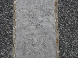 Vintage African beaded banner, hand made by the Yoruba People of Nigeria, white glass beads and cowry shells on fabric, ancestor figures and elephants, there is a beaded loop at the top  ...