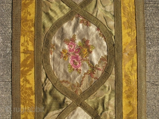 wall hanging, assembled in France ca. 1920's, from older French silk fragments, they are all hand woven silk brocade, including the trim which is brocade silk wrapped with metal foil, the metal  ...