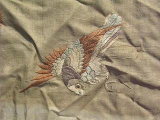 Antique Chinese embroidery, two birds rendered in silk on beige / champagne silk, this is a fragment of a larger textile, I think one bird is a magpie on the left, and  ...
