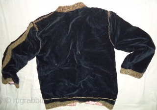 Handmade black velvet metalic jacket. Size 29inch by 21inch. Excellent condition.