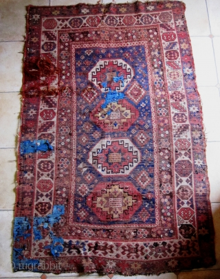 A 19th Century Memling-gul Kazak  Size 133 x 202 cm  Great colours, including aubergine, pale green, yellow, two reds and two blues Interesting borders with a naively drawn 'crab border' at one end. Pile is  ...