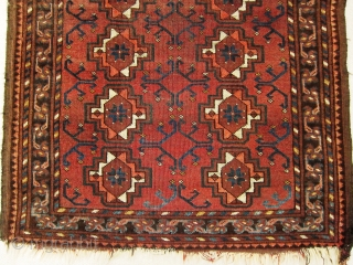 A late 19th century Ersari  Rug   Size 145 x 78 cm  An Ersari small rug with chuval guls, simplified dyrnak secondary motif and lively shudur main border. Overall even flat wear with  ...